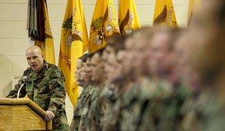 **FILE** Col. H.R. McMaster, 71st Commander of the Regiment, looks to the soldiers during the Third Armored Cavalry Reenlistment Ceremony at Waller Gym at Fort Carson in Colorado Springs, Colo., on Dec. 1, 2004. (Associated Press)
