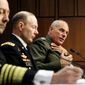 Adm. James G. Stavridis (left), U.S. European Command and Supreme Allied Commander, Europe, and Gen. Charles H. Jacoby, Jr. (center), U.S. Northern Command and Commander of the North American Aerospace Defense Command, listen while Marine Gen. John F. Kelly answers a question while testifying before the Senate Armed Services Committee on Capitol Hill in Washington on March 19, 2013. (Associated Press)