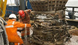An expedition led by Amazon CEO Jeff Bezos pulled up two rocket engines, including this one, that helped boost Apollo astronauts to the moon. Bezos and NASA announced the recovery on Wednesday, March 19, 2013. The sunken engines were part of the Saturn V rocket used to bring astronauts to the moon during the 1960s and 1970s. (AP Photo/Bezos Expeditions)