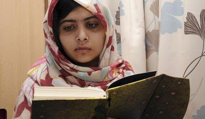 ** FILE ** Malala Yousafzai, the 15-year-old Pakistani girl who was shot in the head at close range by a Taliban gunman in October, reads a book as she continues her recovery at the Queen Elizabeth Hospital in Birmingham, England, in this undated photo. (AP Photo/Queen Elizabeth Hospital)