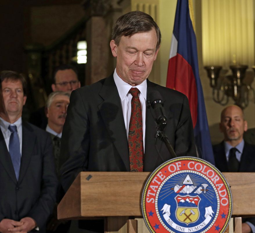 Colorado Gov. John Hickenlooper pauses at a news conference at the Capitol in Denver on March 20, 2013, as he talks about the shooting death of Tom Clements, the state corrections chief. Clements was shot at his home in Monument, Colo., the previous night. (Associated Press)