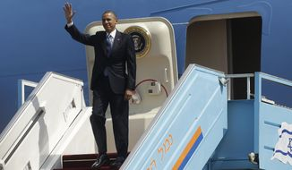 President Barack Obama waves as he steps off Air Force One upon his arrival at Ben Gurion International Airport in Tel Aviv, Israel, Wednesday, March 20, 2013, (AP Photo/Pablo Martinez Monsivais)