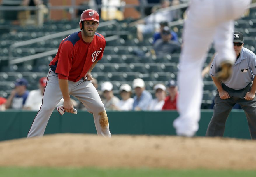 Washington Nationals' Bryce Harper gets a lead off first during the fifth inning of an exhibition spring training baseball game against the Miami Marlins Wednesday, March 20, 2013, in Jupiter, Fla. (AP Photo/Jeff Roberson)