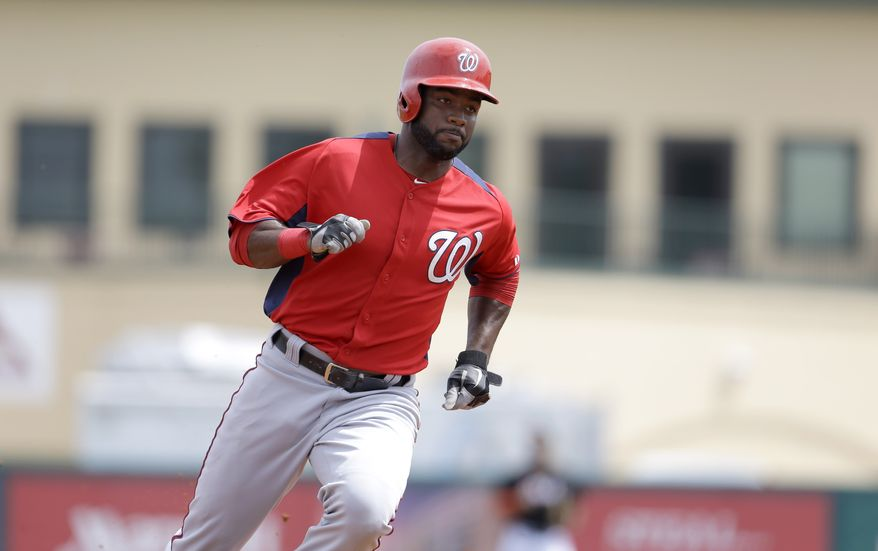 Washington Nationals' Denard Span runs in to score on an two-run double by Bryce Harper during the third inning of an exhibition spring training baseball game against the Miami Marlins Wednesday, March 20, 2013, in Jupiter, Fla. (AP Photo/Jeff Roberson)