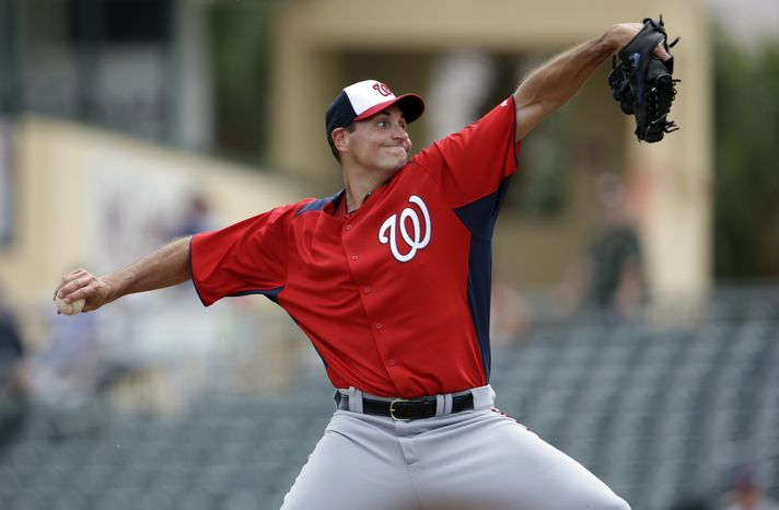 Washington Nationals starting pitcher Chris Young throws during the first inning of an exhibition spring training baseball game against the Miami Marlins Wednesday, March 20, 2013, in Jupiter, Fla. (AP Photo/Jeff Roberson)