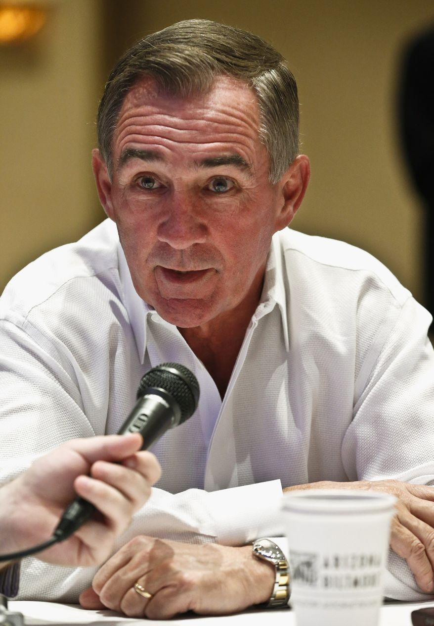 Washington Redskins head coach Mike Shanahan answers a question from the media during the NFC coaches breakfast at the NFL football annual meetings Wednesday, March 20, 2013, in Phoenix. (AP Photo/Ross D. Franklin)