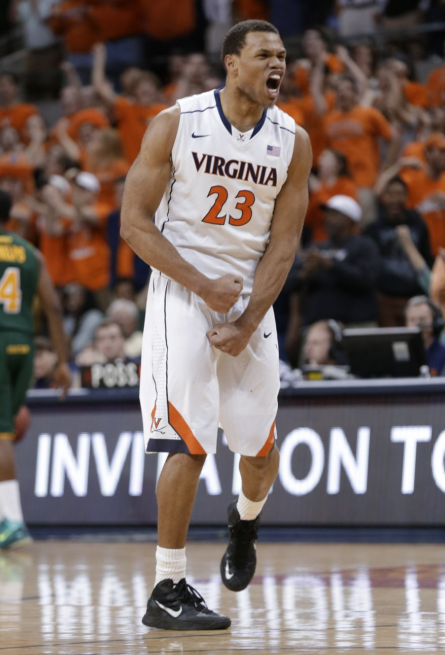 Virginia guard Justin Anderson celebrates a basket during the second half of an NIT first-round college basketball game in Charlottesville, Va., Tuesday, March 19, 2013. Virginia won 67-56. (AP Photo/Steve Helber)