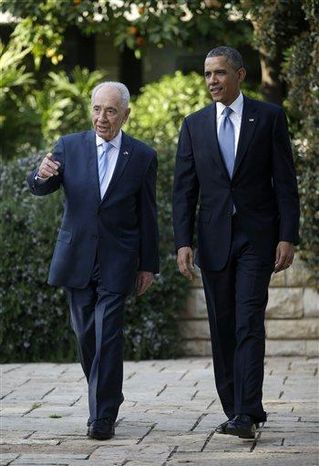 President Obama tours the garden of the President's Residence with Israeli President Shimon Peres in Jerusalem, Israel, Wednesday, March 20, 2013, (AP Photo/Pablo Martinez Monsivais)