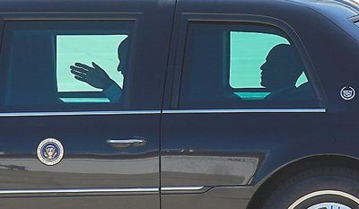 President Obama (right) rides in his limousine on the apron at General Mitchell International Airport in Milwaukee on Wednesday, June, 30, 2009, after attending a town-hall meeting in Racine, Wis. (AP Photo/Jeffrey Phelps)