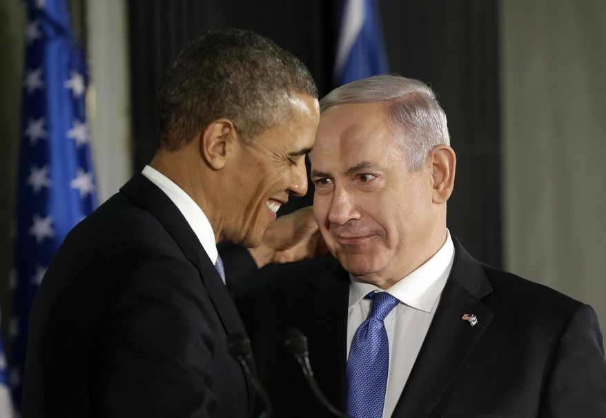 ** FILE ** President Obama and Israeli Prime Minister Benjamin Netanyahu talk during their joint news conference in Jerusalem on Wednesday, March 20, 2013. (AP Photo/Pablo Martinez Monsivais)