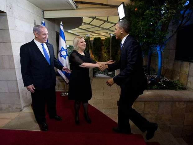 President Obama is greeted by Israeli Prime Minister Benjamin Netanyahu and his wife, Sara, at the prime minister's residence in Tel Aviv on Wednesday, March 20, 2013. (AP Photo/The New York Times, Doug Mills, Pool)