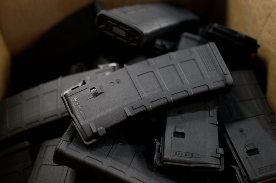 Newly-assembled 30-round capacity ammunition magazines for high-velocity rifles are stacked awaiting packaging inside the Magpul Industries plant, in Erie, Colo. The company plans to relocate now that gun control bills have become law. (Associated Press)