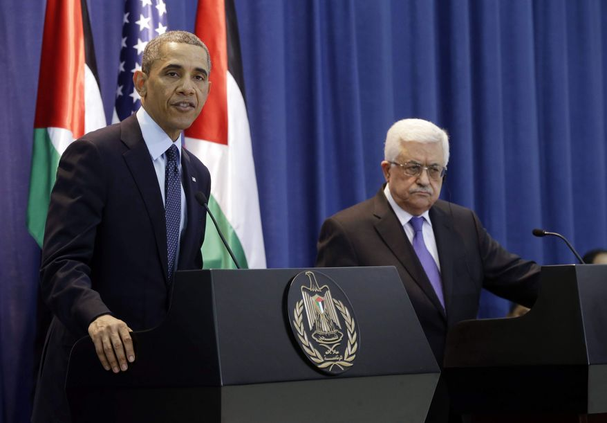 **FILE** President Obama and Palestinian President Mahmoud Abbas speak to reporters during their joint news conference at the Muqata President Compound in the West Bank city of Ramallah on March 21, 2013. (Associated Press)