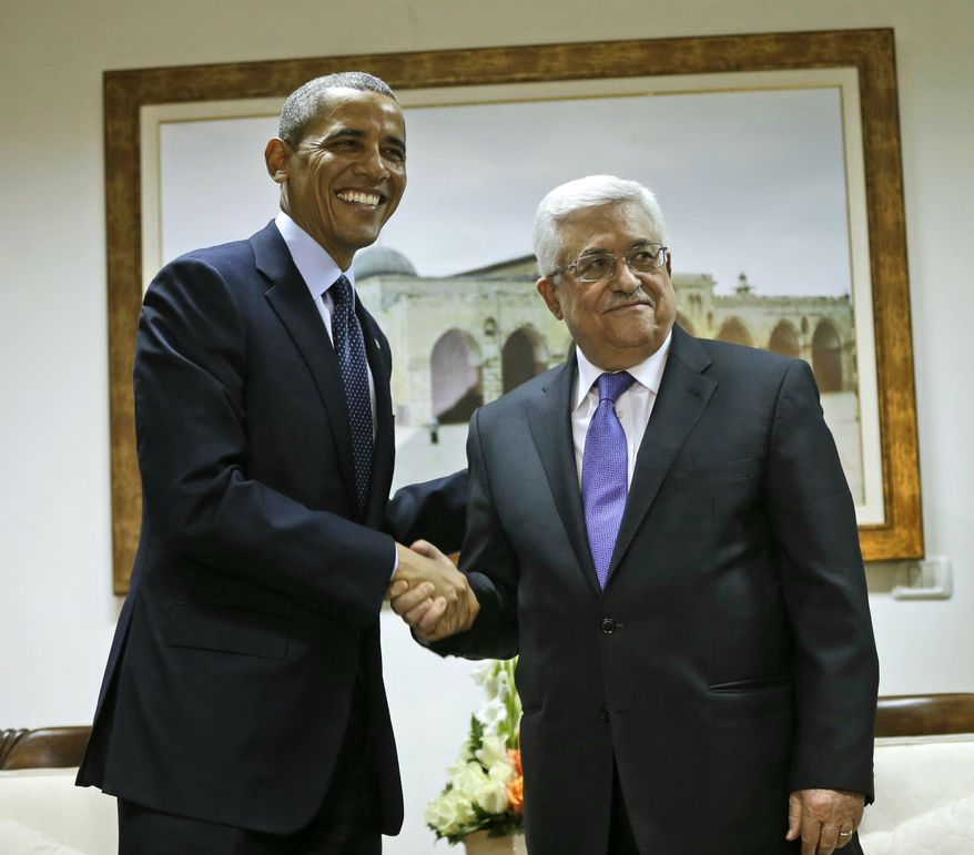 U.S. President Barack Obama and Palestinian President Mahmoud Abbas shake hands during their bilateral meeting at the Muqata Presidential Compound in the West Bank city of Ramallah, Thursday, March 21, 2013. (AP Photo/Pablo Martinez Monsivais)