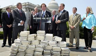 **FILE** Rep. Phil Gingrey (center), Georgia Republican and obstetrician, speaks June 28, 2012, during a news conference on Capitol Hill in Washington by the GOP Doctors Caucus in response to the Supreme Court ruling on President Obama's health care plan. (Associated Press)