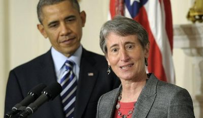 **FILE** President Obama listens as his Interior Secretary nominee, REI Chief Executive Officer Sally Jewell, speaks in the State Dining Room of the White House in Washington on Feb. 6, 2013. (Associated Press)