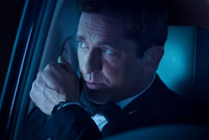 """This film image released by FilmDistrict shows Gerard Butler in a scene from """"Olympus Has Fallen."""" (AP Photo/FilmDistrict, Phil Caruso)"""