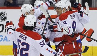 Washington Capitals celebrate a goal by Marcus Johansson against the Winnipeg Jets during the first period of an NHL hockey game in Winnipeg, Manitoba, on Thursday, March 21, 2013. (AP Photo/The Canadian Press, John Woods)
