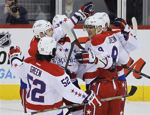 Washington Capitals celebrate a goal by Marcus Johansson against the Winnipeg Jets during the first period of an NHL hockey game in Winnipeg, Manitoba, on Thursday, March 21, 2013. (AP Photo/The Canadian Pres