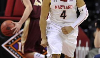 Maryland's Seth Allen (4) reacts after scoring against Denver late in the second half of a second-round game in the NIT college basketball tournament in College Park, Md., Thursday, March 21, 2013. Maryland won 62-52. (AP Photo/Gail Burton)