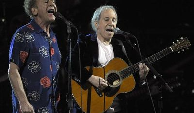 ** FILE ** Paul Simon (right) and Art Garfunkel perform at the 25th Anniversary Rock & Roll Hall of Fame concert at Madison Square Garden in New York on Oct. 29, 2009. (AP Photo/Henny Ray Abrams)