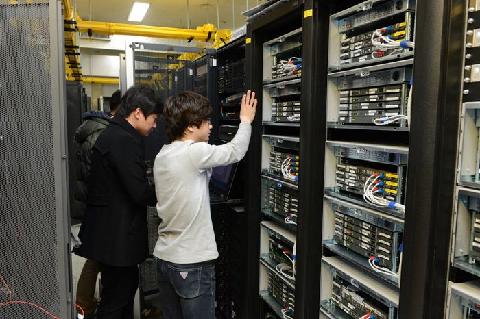 Korean Broadcasting System employees in Seoul try to recover a computer server on Thursday, March 21, 2013, a day after a cyberattack caused computer networks at the company and six South Korean banks to crash. (AP Photo/Korean Broadc