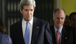 **FILE** Secretary of State John F. Kerry (left), followed by National Security Adviser Tom Donilon, arrives for the joint news conference between President Obama and Israeli Prime Minister Benjamin Netanyahu in Jerusalem on Wednesday, March 20, 2013. (Associated Press)