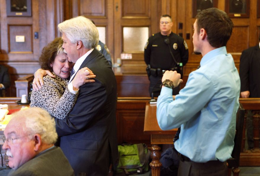 Mark Strong Sr. comforts his wife Julie after she became emotional while addressing Justice Nancy Mills during Strong's sentencing at Cumberland County Superior Court in Portland, Maine, on March 21, 2013. Strong was sentenced to 20 days in jail and a fine of $3,000 for his role in promoting a one-woman prostitution business from a Zumba studio in Kennebunk. (Associated Press/Portland Press Herald)