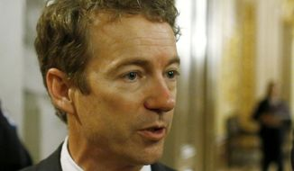 **FILE** Sen. Rand Paul, Kentucky Republican, talks to reporters on Capitol Hill in Washington on March 7, 2013. (Associated Press)