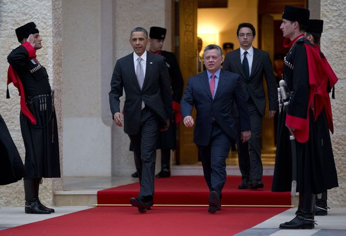President Barack Obama walks with Jordan's King Abdullah II to participate in an official arrival ceremony at the Al-Hummar Palace, the residence of Jordanian King Abdullah II, Friday, March 22, 2013, in Amman, Jordan. (AP Photo/Caroly
