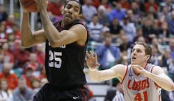 Harvard's Kenyatta Smith, left, catches a pass as New Mexico's Cameron Bairstow defends in the first half during a second-round game in the NCAA men's college basketball tournament in Salt Lake City on Thursday, March 21, 2013. (AP Photo/George Frey)