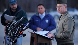 Col. David W. Maxwell holds a press conference at the Marine Corps Museum in Quantico, Va., on Friday, March 22, 2013, regarding a murder/suicide that occurred on Thursday night that resulted in the deaths of three Marines. A Marine killed a male and female colleague in a shooting at a base in northern Virginia before killing himself, officials said early Friday. (AP Photo/The Free Lance-Star, Peter Cihelka)