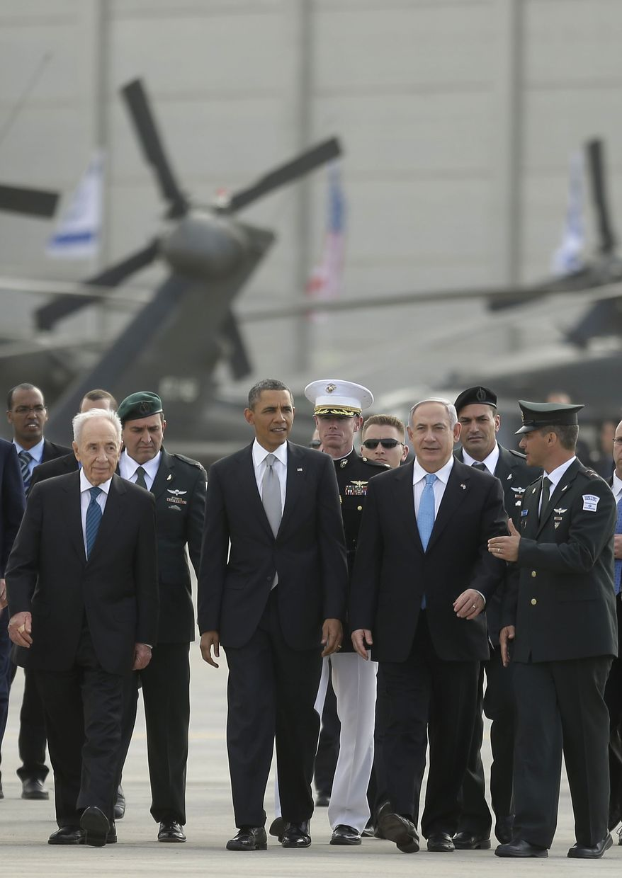 President Obama walks with Israeli Prime Minister Benjamin Netanyahu (right) and Israeli President Shimon Peres (left) across the tarmac prior to his departure from Ben Gurion International Airport in Tel Aviv on March 22, 2013. (Associated Press)