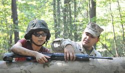 ** FILE ** Sgt. Eusebio Lopez instructs a woman during the Quantico Leadership Venture at OCS on Sept. 21. The venture is a bi-annual event that exposes students to the leadership development and evaluation process used by the United States Marine Corps. (Flickr, U.S. Marine Corps)