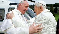 ** FILE ** Pope Francis (left) meets Pope Emeritus Benedict XVI at Castel Gandolfo, the Vatican's summer residence, on Saturday, March 23, 2013. The new pontiff had lunch with his predecessor in a historic and potentially problematic melding of the papacies that has never before confronted the Catholic Church. (Associated Press)