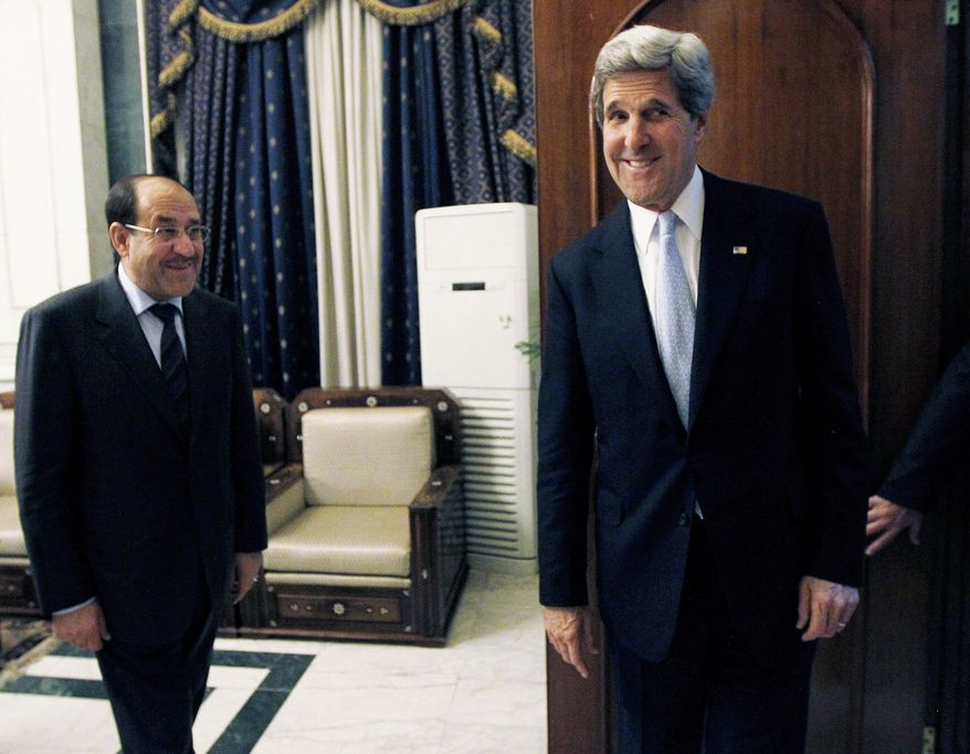U.S. Secretary of State John F. Kerry (right) meets with Iraqi Prime Minister Nouri al-Maliki in Baghdad on Sunday, March 24, 2013. Mr. Kerry, on an unannounced visit to Iraq, was expected to urge Mr. al-Maliki to make sure Iranian flights over Iraq do not carry arms and fighters to Syria, a U.S. official said. (AP Photo/Jason Reed, Pool)