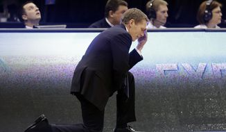 Gonzaga coach Mark Few lowers his head near the end of their third-round game in the NCAA college basketball tournament against Wichita State in Salt Lake City, Saturday, March 23, 2013. Wichita State won 76-70. (AP Photo/Rick Bowmer)