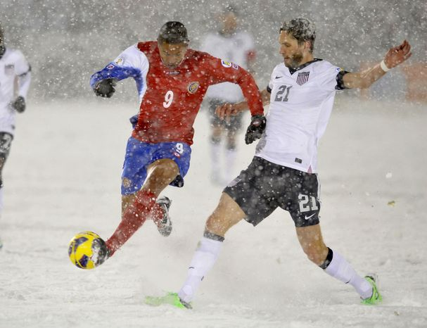 Costa Rica forward Alvaro Saborio (9) and United States defender Clarence Goodson (21) go after the ball during the second half of a World Cup qualifier soccer match in Commerce City, Colo., Friday, March 22, 2013