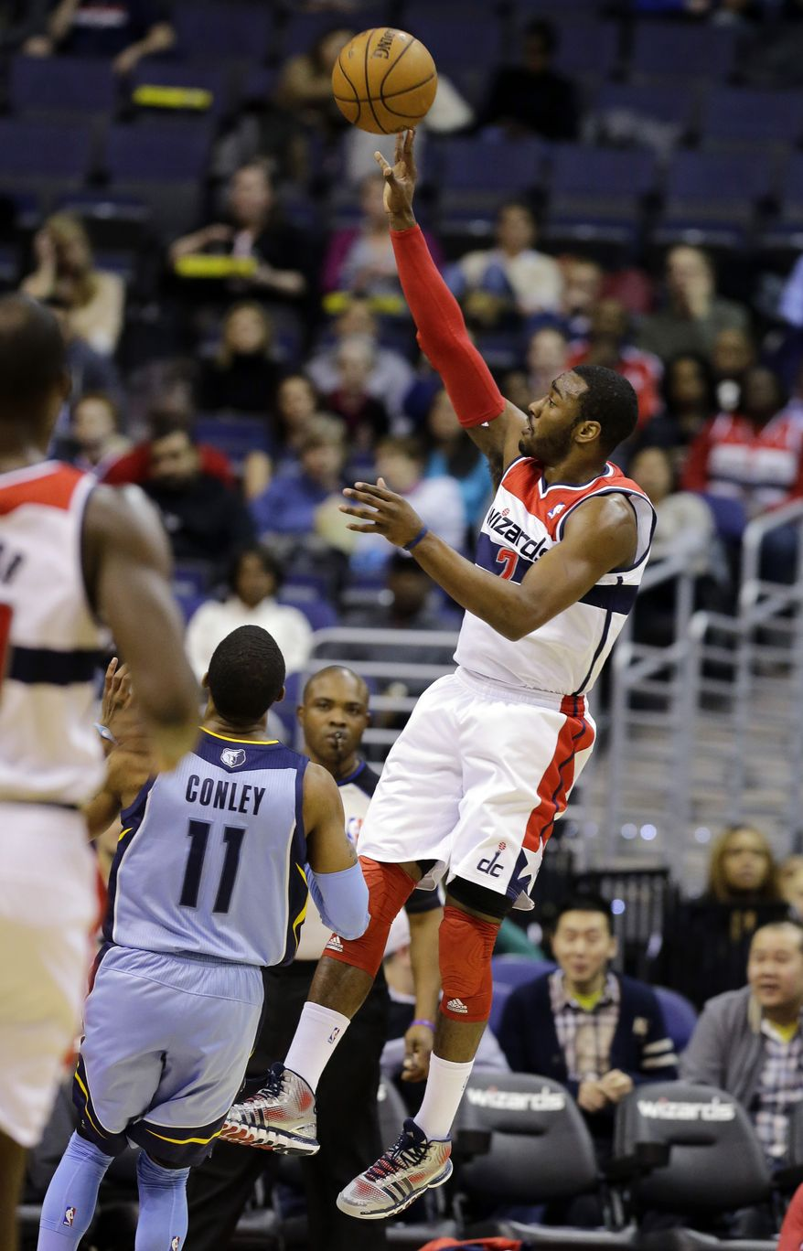 Washington Wizards guard John Wall shoots over Memphis Grizzlies guard Mike Conley (11) in the first half of an NBA game Monday in Washington. (AP Photo/Alex Brandon)