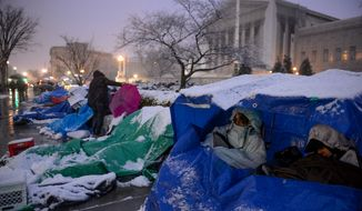 LGBT supporters camp outside of the U.S. Supreme Court in anticipation of the oral arguments on Hollingsworth vs. Perry and Windsor vs. United States, Washington, D.C., Monday, March 25, 2013. (Andrew Harnik/The Washington Times)