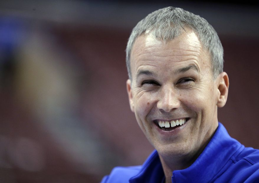 Florida Gulf Coast coach Andy Enfield laughs while talking with broadcasters during practice for a second-round game of the NCAA men's college basketball tournament, Thursday, March 21, 2013, in Philadelphia. Florida Gulf Coast is scheduled to play Georgetown on Friday. (AP Photo/Matt Slocum)