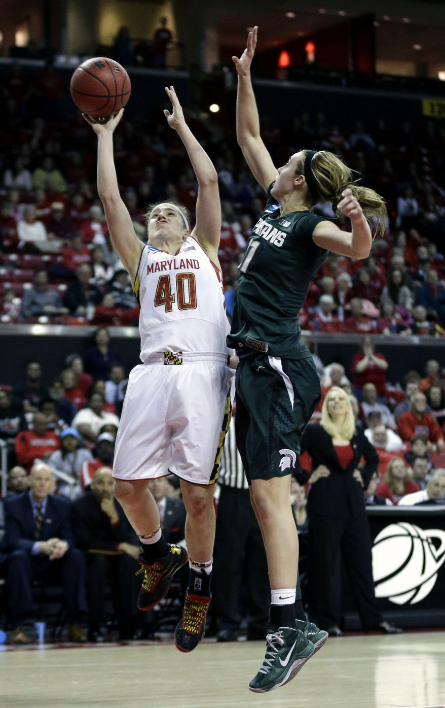 Maryland guard Katie Rutan, left, shoots over Michigan State forward Annalise Pickrel during the second half of a second-round game in the women's NCAA college basketball tournament in College Park, Md., Monday, March 25, 2013. Rutan contributed 18 points to Maryland's 74-49 win. (AP Photo/Patrick Semansky)