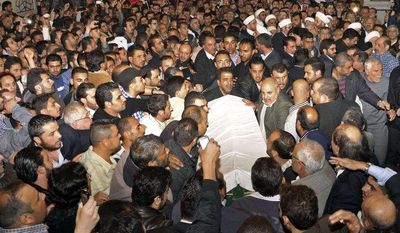 In this photo released by the Syrian official news agency SANA, mourners carry the body of Sheik Mohammad Said Ramadan al-Buti, an 84-year-old pro-government cleric during his funeral in the eighth century Omayyad Mosque, in Damascus, Syria, Saturday, March 23, 2013. (AP Photo/SANA)