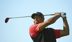 Tiger Woods hits a shot from the third tee during the final round of the Arnold Palmer Invitational golf tournament, Monday, March 25, 2013, in Orlando, Fla. (AP Photo/Phelan M. Ebenhack)