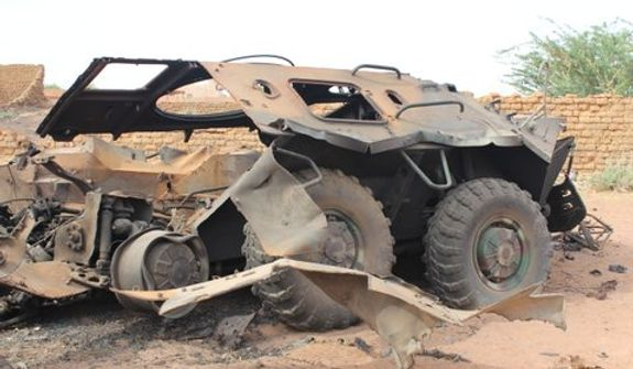 John Price, former U.S. Ambassador to the Seychelles, snaps a photo of a destroyed vehicle during his trip to Mali and Somaliland. (courtesy photo)