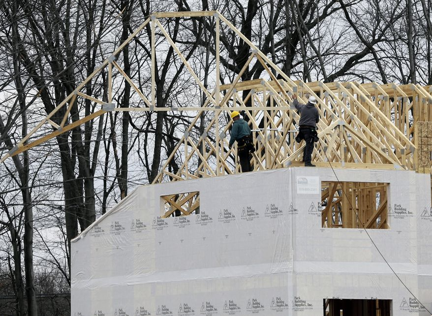 A new town house is under construction at the Crossings adult community in Colonie, N.Y., on Monday, Feb. 25, 2013. (AP Photo/Mike Groll)