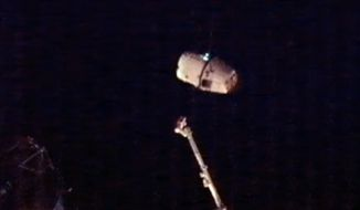 The SpaceX Dragon commercial cargo craft backs away from the International Space Station's Canadarm2 robotic arm early on Tuesday, March 26, 2013, for its return to Earth. The Dragon is expected to splash down in the eastern Pacific Ocean approximately 246 miles off the coast of Baja California later in the morning. (AP Photo/NASA)