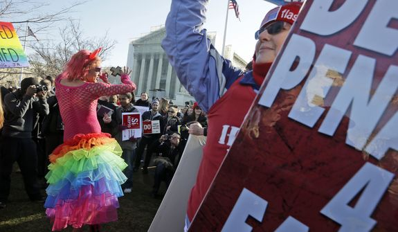 Qween Amar (left) from Orlando, Fla., dances March 26, 2013, by Margie Phelps (right), a member of the Westboro Baptist Church, outside the Supreme Court in Washington,where the court will hear arguments on California's voter approved ban on same-sex marriage, Proposition 8. (Associated Press)