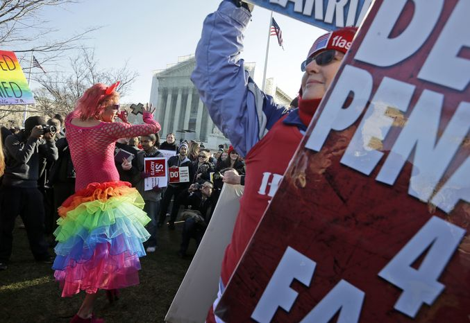 Qween Amar (left) from Orlando, Fla., dances March 26, 2013, by Margie Phelps (right), a member of the Westboro Baptist Church, outside the Supreme Court in Washington,where the court will hear arguments on California's voter approved ban on same-sex