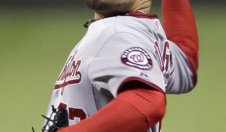 **FILE** Washington Nationals pitcher Henry Rodriguez throws in the ninth inning of a baseball game against the Pittsburgh Pirates in Pittsburgh Thursday, May 10, 2012. (AP Photo/Gene J. Puskar)